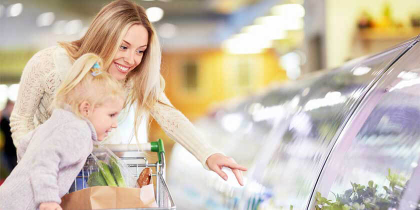 mother and daughter shopping groceries