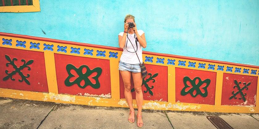 woman taking photos on domestic trip