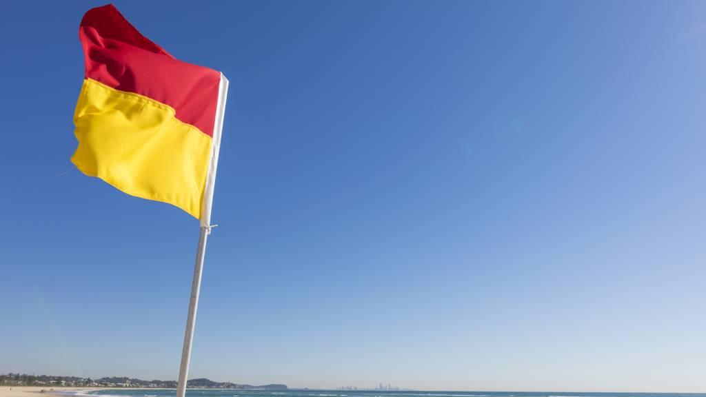 Surf lifesaving red and yellow flag on an Australian beach.