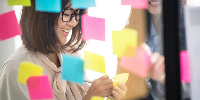 woman using post notes