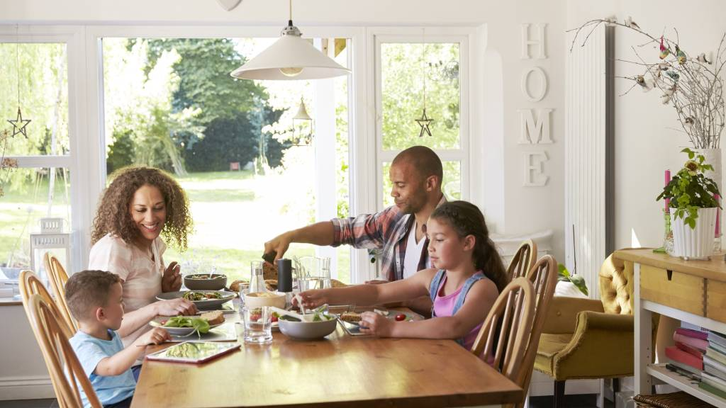 family at dinner table in home