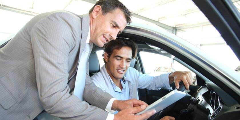 customer discussing insurance options at car dealer