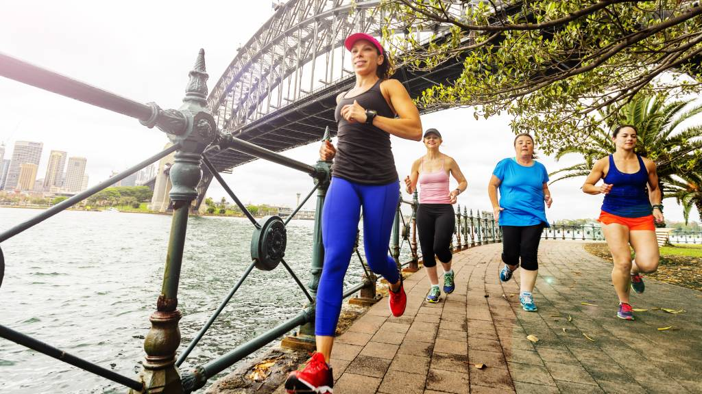 Running group near Sydney Harbour Bridge
