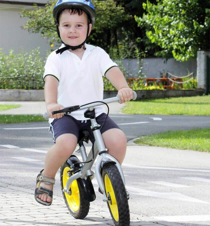 child riding bike with no pedals