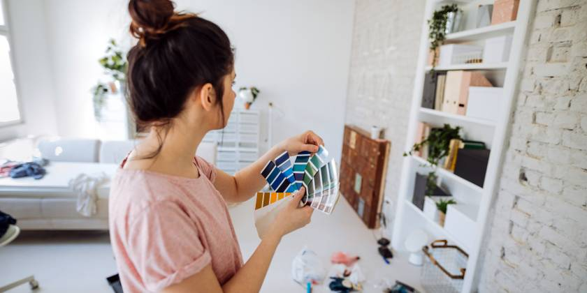 woman choosing wallpaper colours