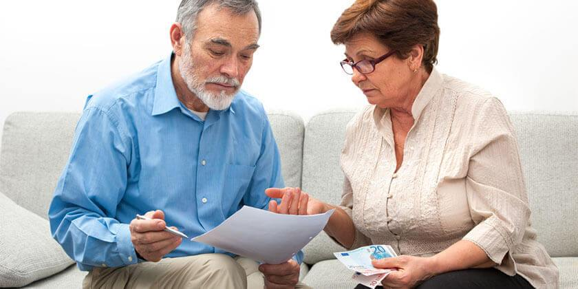older couple managing finances at home