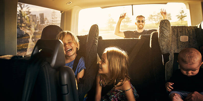 young family in car