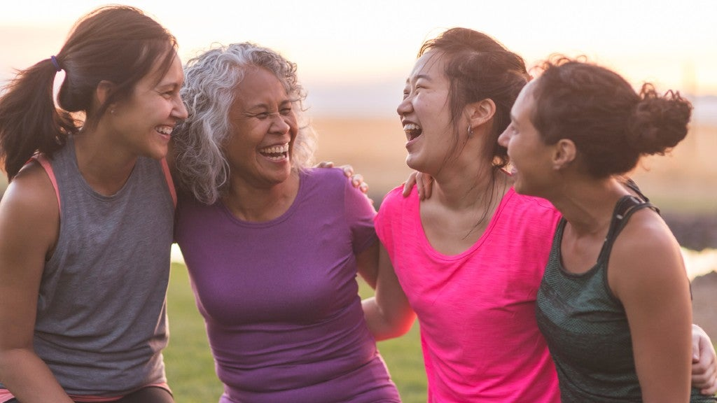 Women of various ages in exercise gear, smiling