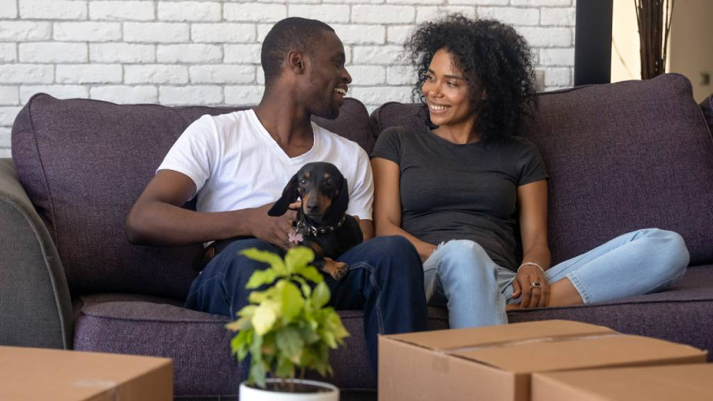 young couple at home with new dog