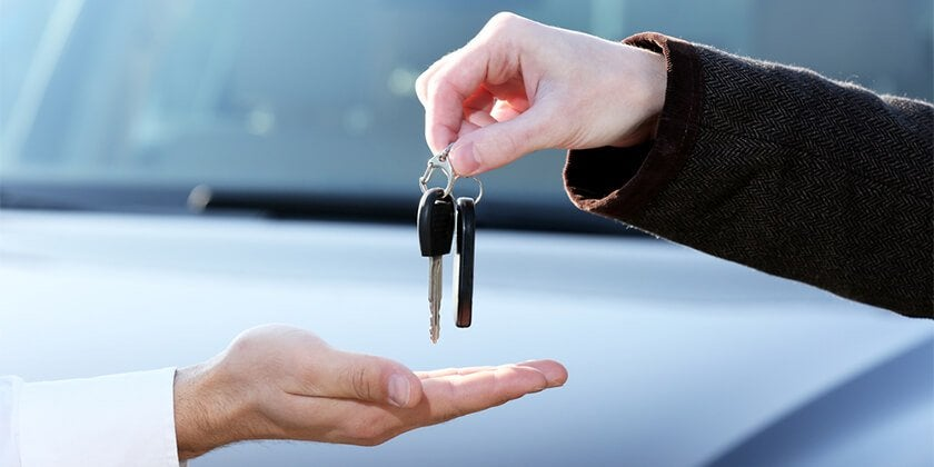 handing over keys to sold car