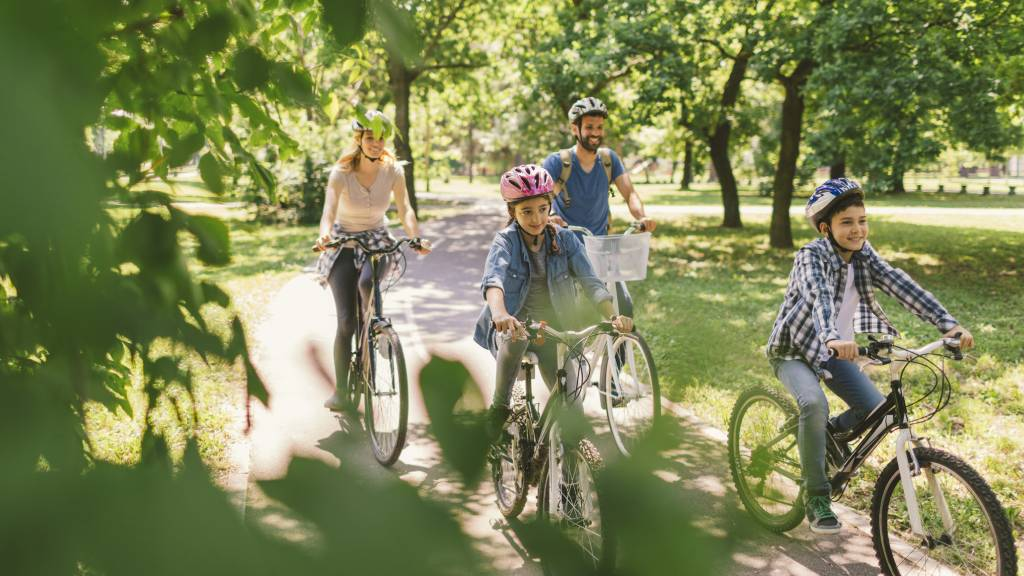 Family riding bikes together outdoors