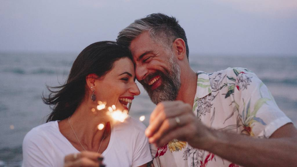 romantic couple in love smiling on beach