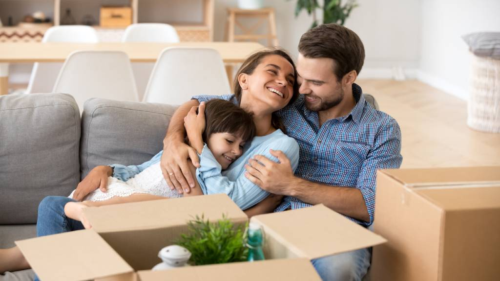 couple with child smiling at home