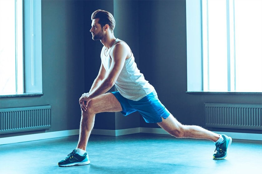 man doing walking lunge stretch