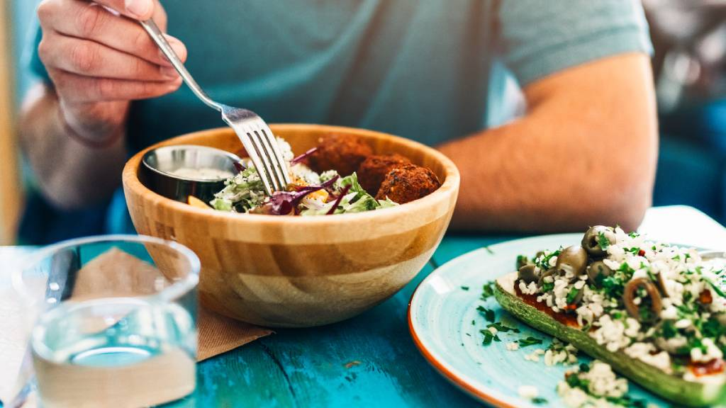 Man eating a bowl of vegan protein food