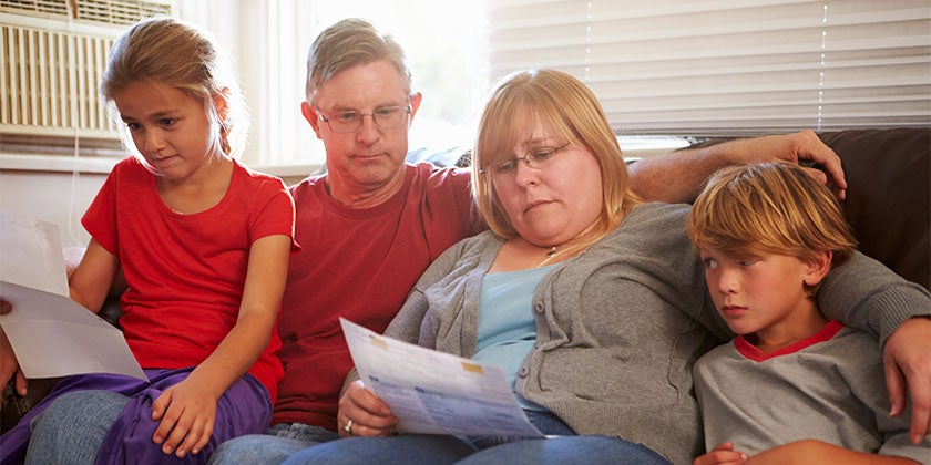 Australian family reading bills