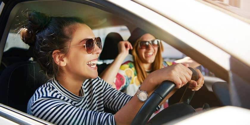 young women driving