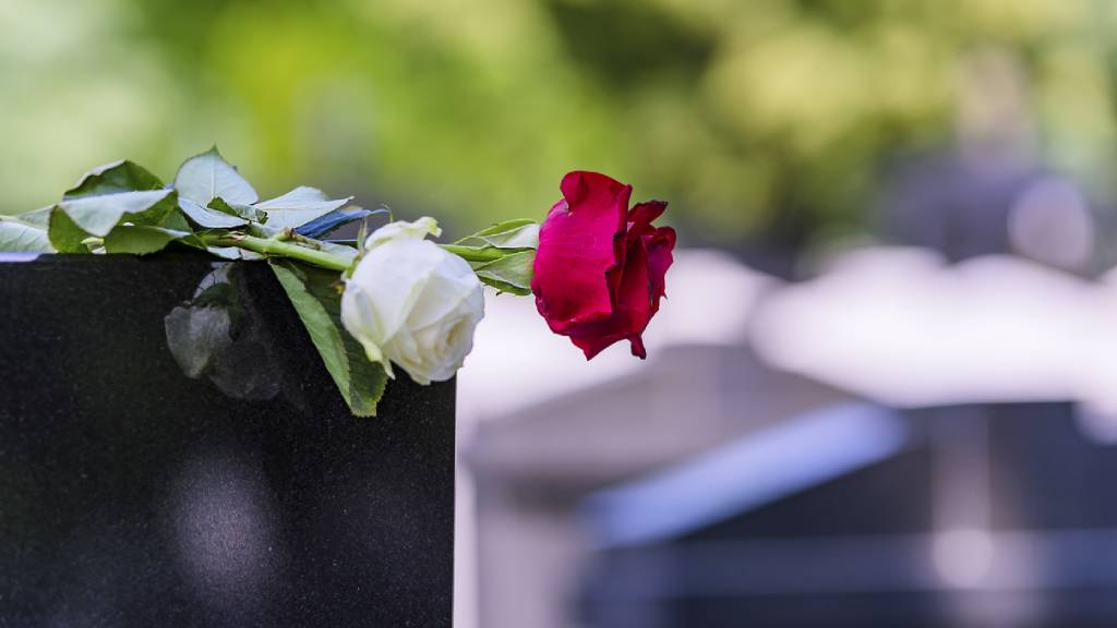 flowers on a tombstone at a funeral