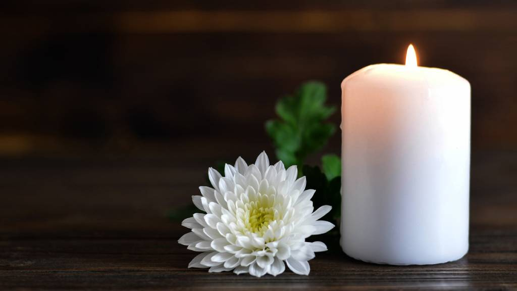 flower and candle at a funeral