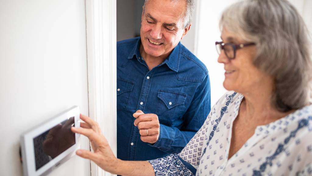 Couple setting a burglar alarm