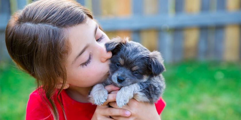 young girl with new puppy