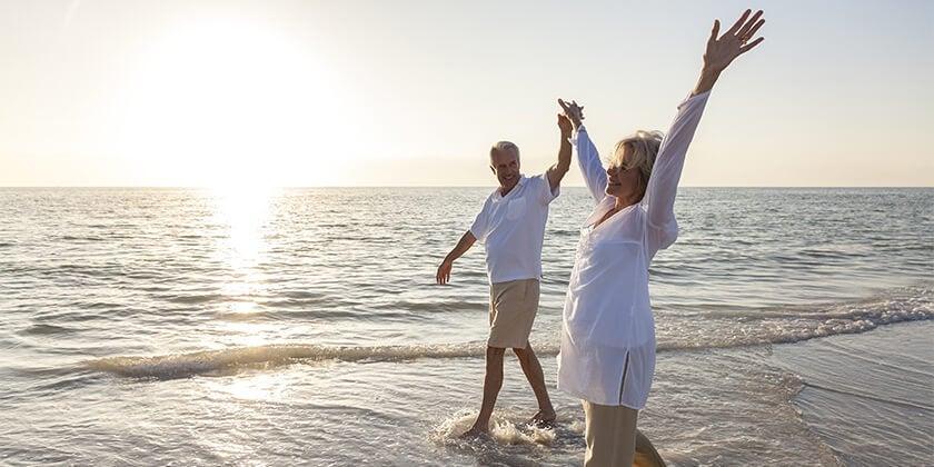 over 55s couple on beach