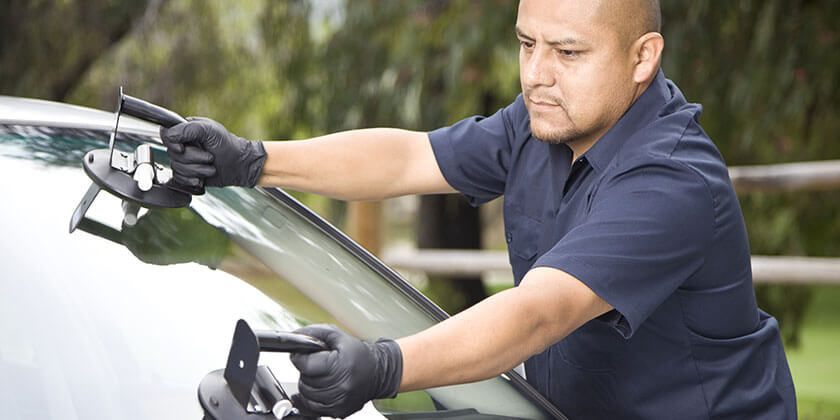 man servicing windshield