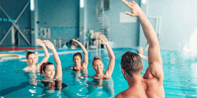 women in indoor swimming pool doing aqua workout