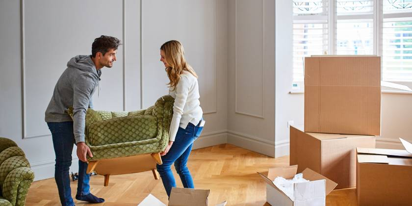 young couple moving into dream home