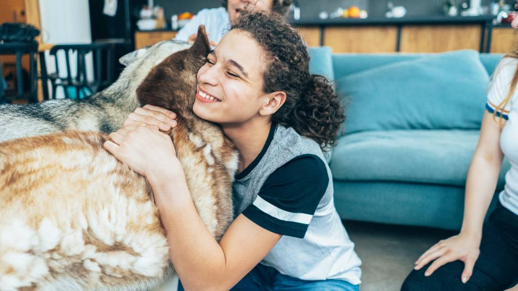 woman saying goodbye to pets before holiday
