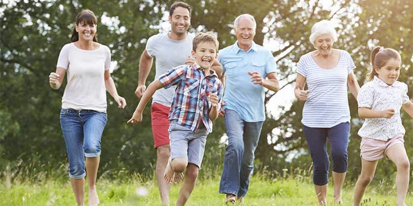 parents, children, and grandparents running outdoors