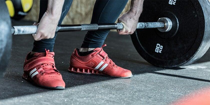 man doing strength workout