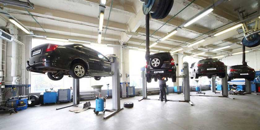 workshop with cars on hoist
