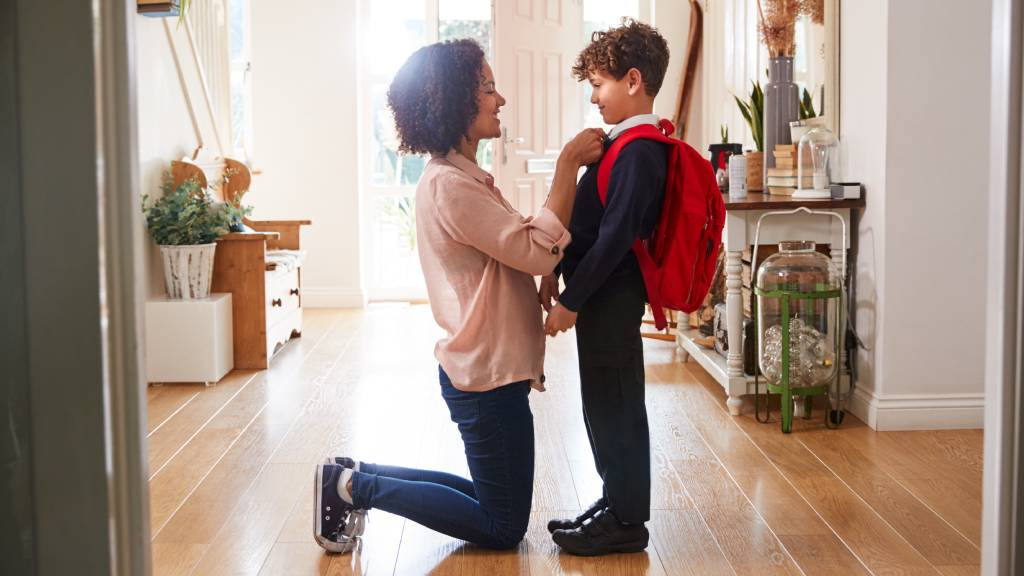 Mother and son getting ready for first day of school