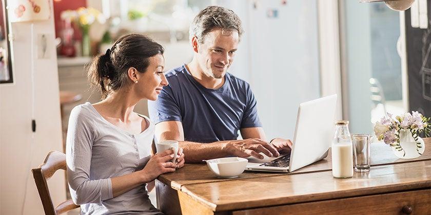 Australian family at home using laptop