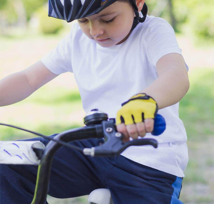 child learning to use pedals on bike