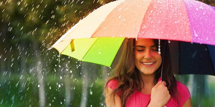 woman using umbrella in rain