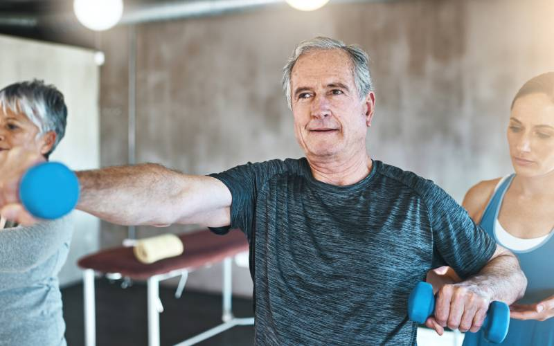 older man in 60s doing workout session