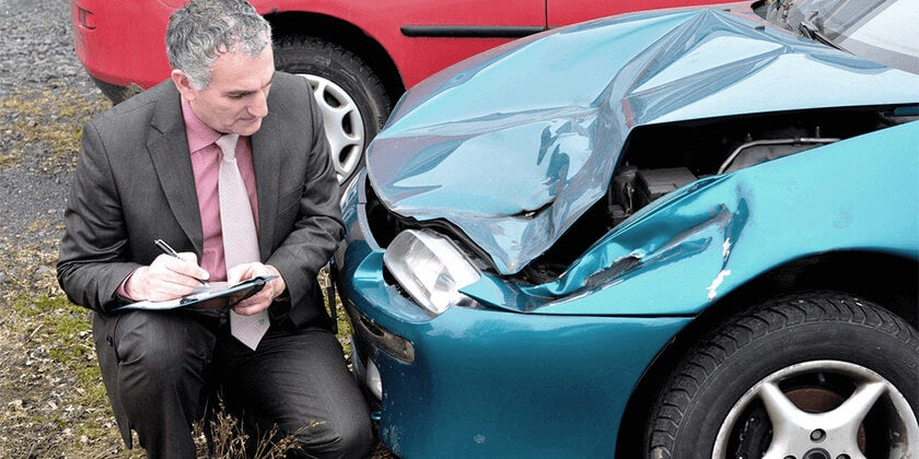 inspecting car accident damage