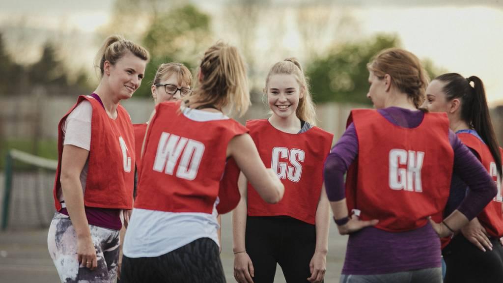 Group of netballers in red bibs