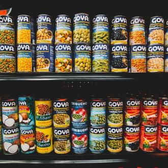 Cans on supermarket shelf