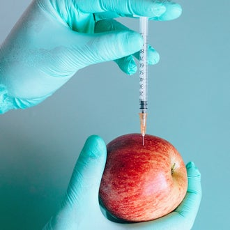 Syringe in an apple
