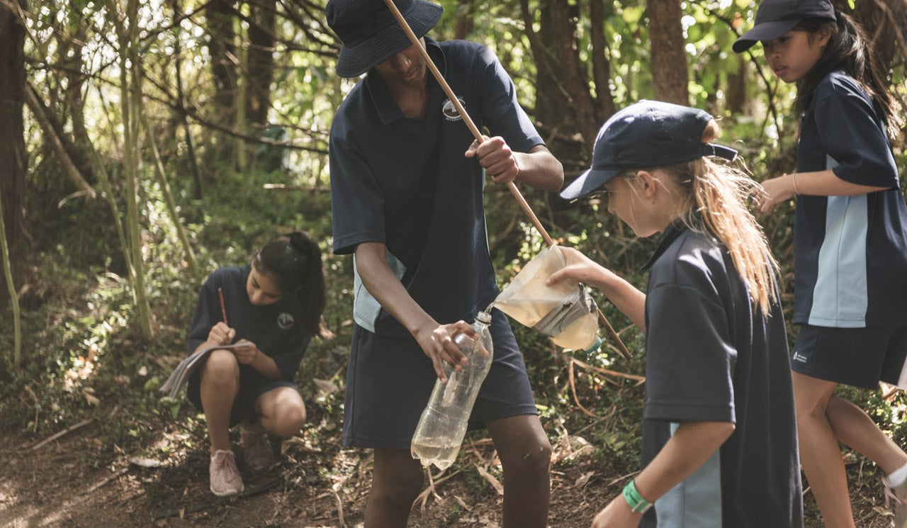 Northcross Intermediate School students carefully collect and measure out water samples, using their Freshwater Detectives Kit. Sample is taken from taken their local stream in Sherwood Reserve.