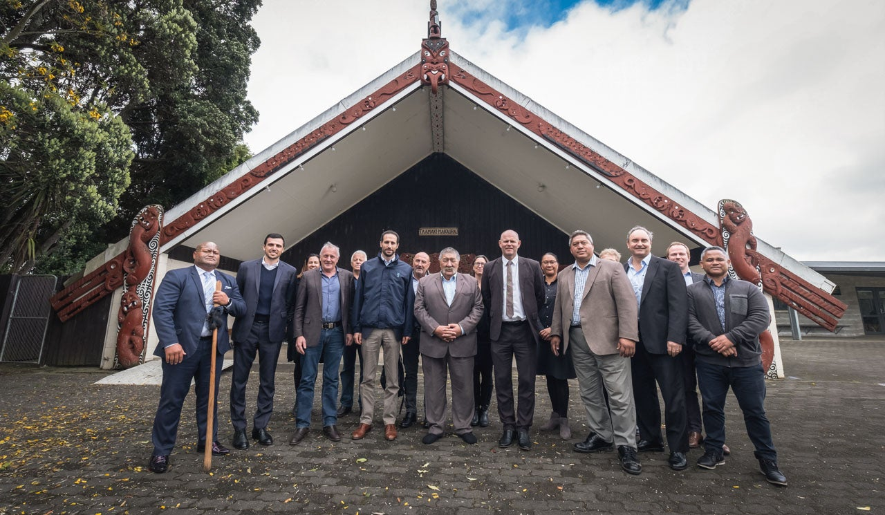Principal Advisor Richie Waiwai is pictured with visitors, guests, project stakeholders and Watercare staff on a marae.