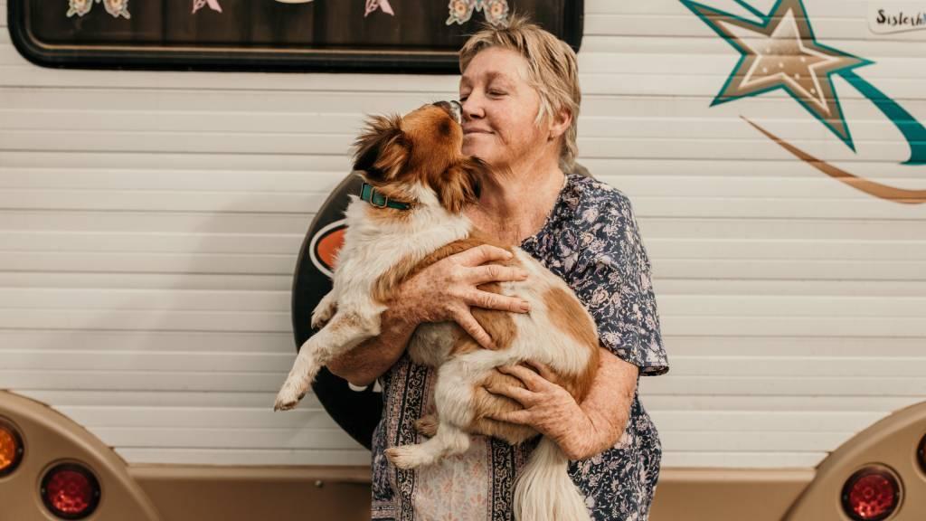 Thalidomide survivor Gaylene Seeney with her dog Albert.
