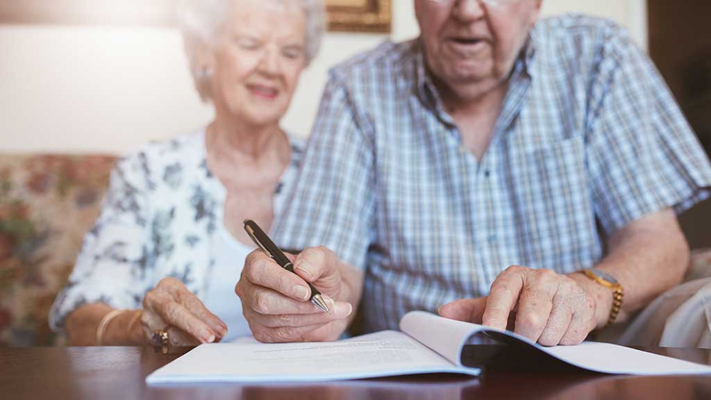 older couple planning at table