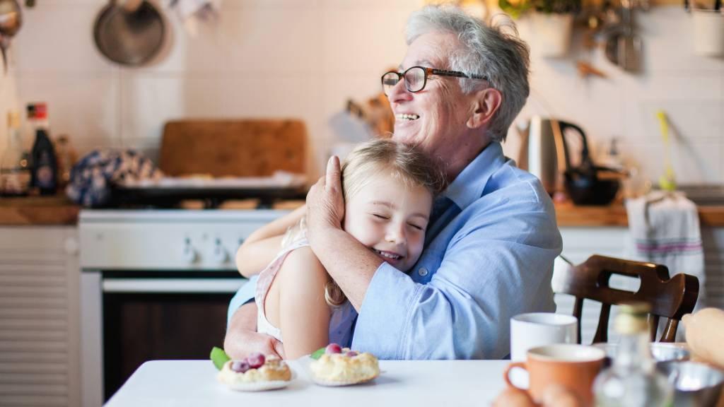 grandparent hugging grandkid