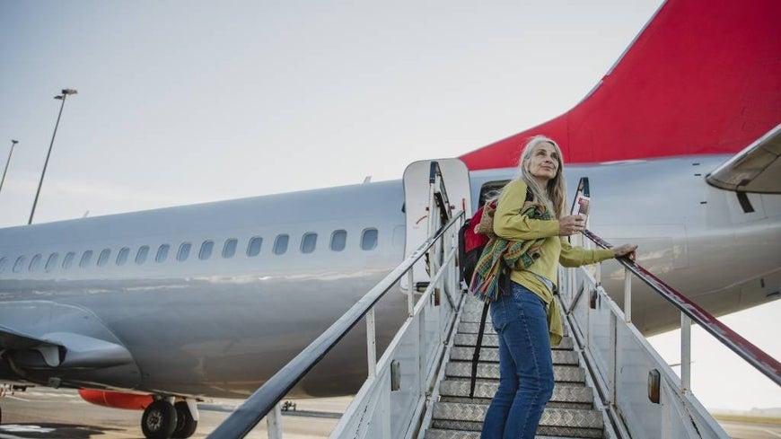 shy woman boarding plane