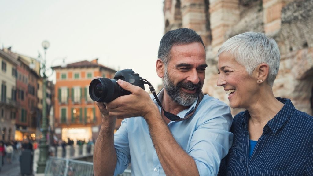 older couple on holidays with camera