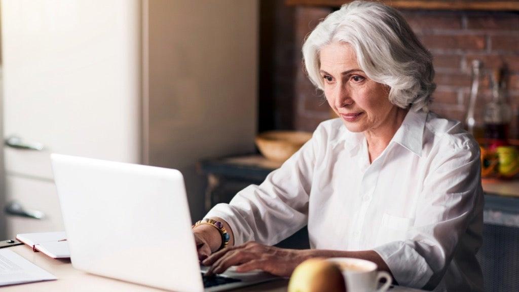 Senior woman writing a eulogy
